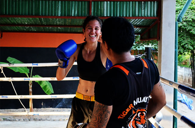 Woman-training-with-Tiger-Muay-Thai-trainer