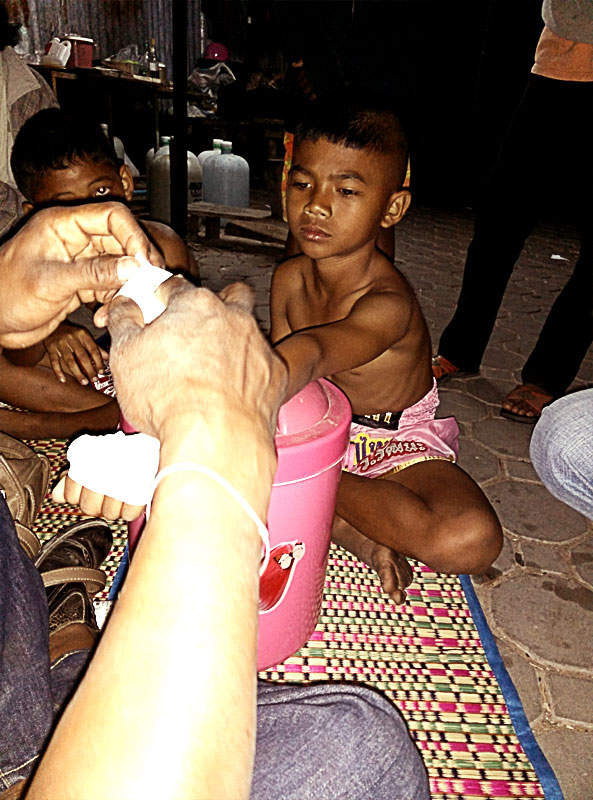 child-muay-thai-fighter-getting-hands-wrapped